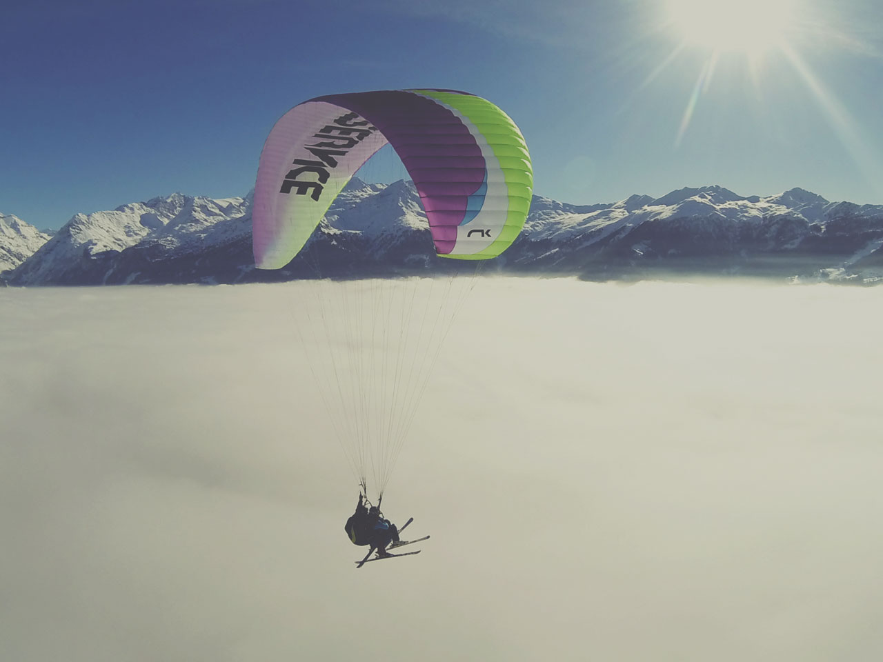 Tandem Paragliding Over The Swiss Alps - Above & Beyond